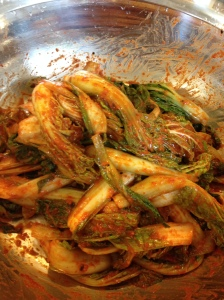 mixing cabbage into kimchi seasoning mixture in a big bowl (Sorry, I couldn't take a picture of mixing moment for making this kimchi. This photo  when I made Korean spring cabbage kimchi.)