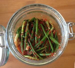 Spring onion kimchi in a glass jar